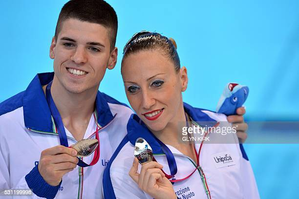 Italian silver medalists Manila Flamini and Giorgio Minisini pose after competing in the Mixed Synchronised Duet Technical Swimming Final on Day 5 of...