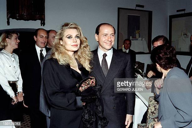 Italian Silvio berlusconi pioneer of commercial television in Europe poses with his wife Veronica Lario as he receives the Man of the year trophy...