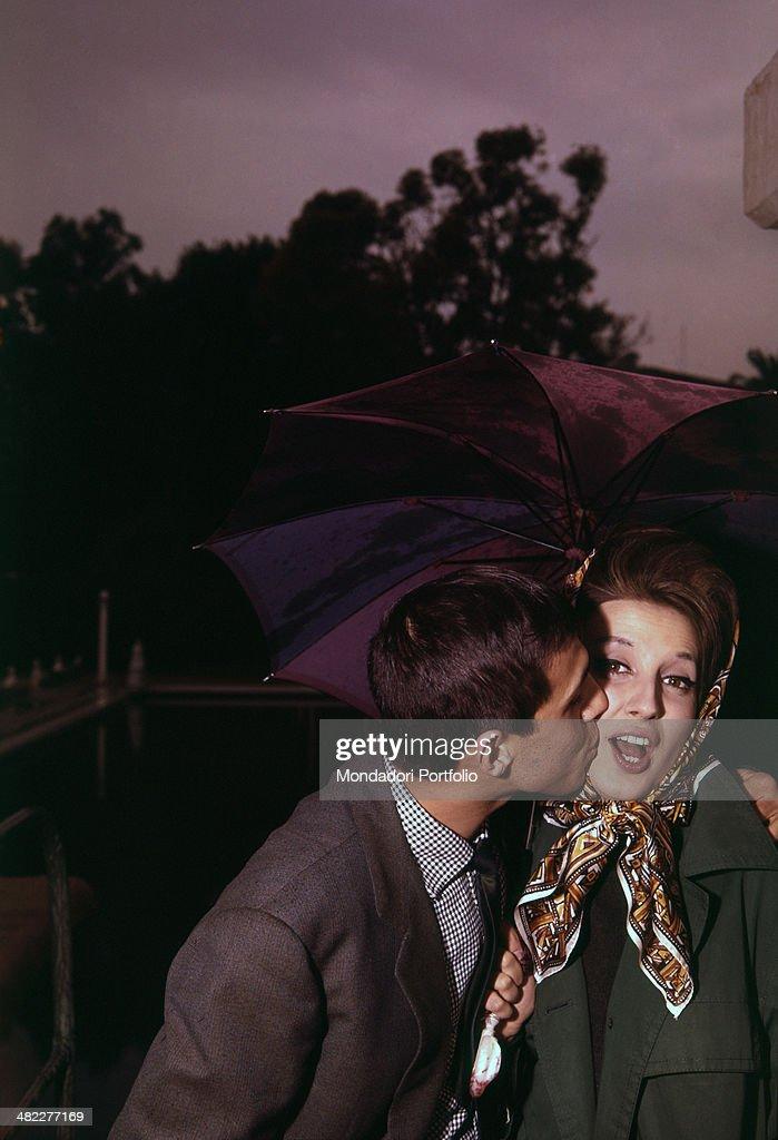 Italian singer Adriano Celentano kissing Italian singer Mina 's cheek at the 11th Sanremo Music Festival Sanremo 1961