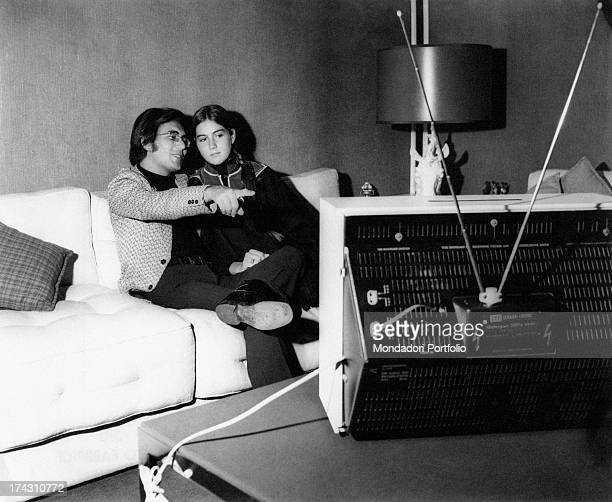 Italian singer Al Bano and his wife Americanborn Italian singer Romina Power watching television Milan 1970s