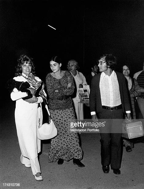 Italian singer Al Bano walking with his wife Americanborn Italian singer Romina Power and Mexicanborn American actress Linda Christian June 1971