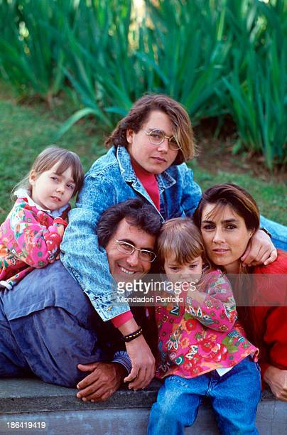 Italian singer and actor Al Bano and Americanborn Italian singer Romina Power posing smiling with their children Yari Cristèl and Romina Jr 1990