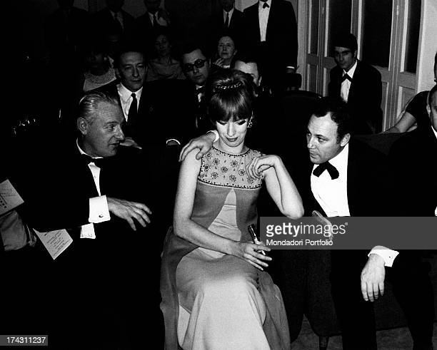 Italian singer and actor Claudio Villa toasting with his mother and his son Mauro after having won the 17st Sanremo Music Festival Sanremo January...