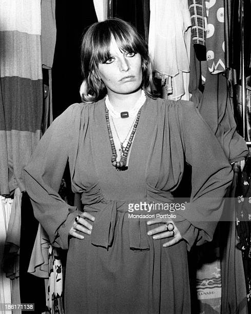 Italian singer and actress Gabriella Ferri posing with her hands on her hips in a clothes shop Milan 1970