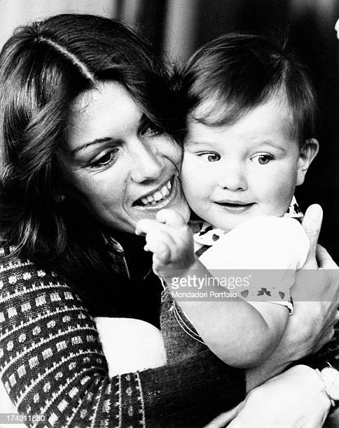 Italian singer and record producer Caterina Caselli holding her son Filippo Sugar in her arms Sanremo 1970s