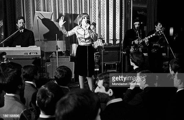 Italian singer and record producer Caterina Caselli singing at a concert Two young men accompanying her with the guitar and the keyboard Turin...