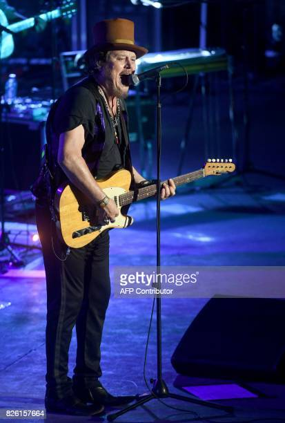 Italian singer and rocker Zucchero performs during the 53rd session of the international Festival of Carthage at the Roman Theatre of Carthage on...