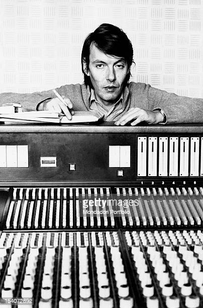 Italian singer and songwriter Fabrizio De Andre leaning on a mixer in a recording studio Milan 1974