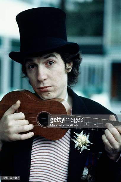 Italian singer and songwriter Rino Gaetano playing ukulele 1978