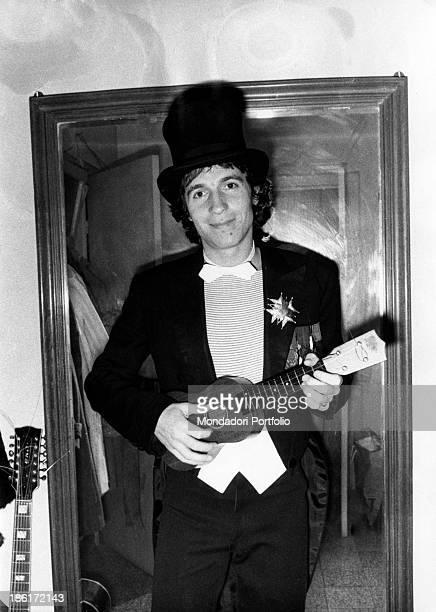 Italian singer and songwriter Rino Gaetano playing ukulele at 28th Sanremo Music Festival Sanremo 1978