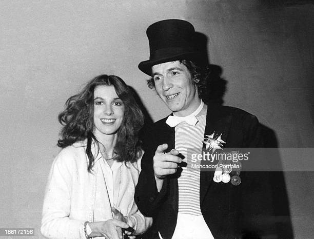 Italian singer and songwriter Rino Gaetano smiling and pointing his finger beside Italian actress Stefania Casini Stefania Casini is one of the...