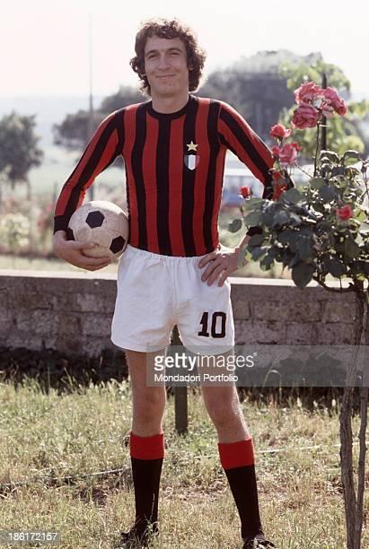 Italian singer and songwriter Rino Gaetano wearing a football strip of the Milan Football Club 1979