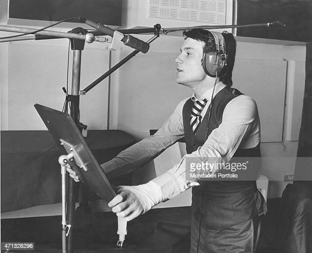 Italian singer and theatre actor Massimo Ranieri at the recording studio Photo shooting Milan September 1972