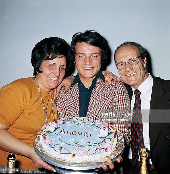 Italian singer and theatre actor Massimo Ranieri holding his birthday cake between his parents Giuseppina Amabile and Umberto Calone Photo shooting...