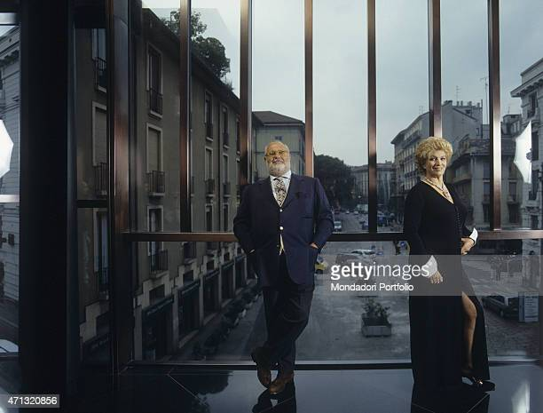 Italian singer and TV presenter Iva Zanicchi in a long dress smiling beside Italian fashion designer Gianfranco Ferr at his atelier on via Pontaccio...