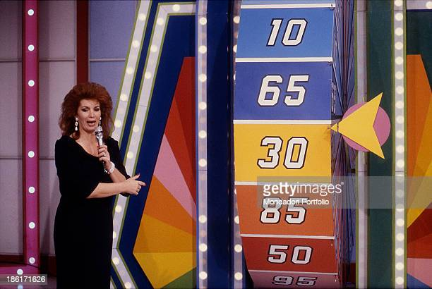 Italian singer and TV presenter Iva Zanicchi speaking into the microphone and turning the wheel in the TV quiz The price is right Cologno Monzese 1991