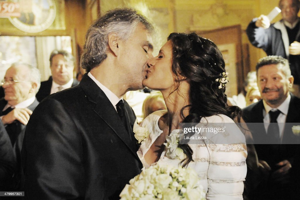 Italian singer <a gi-track='captionPersonalityLinkClicked' href=/galleries/search?phrase=Andrea+Bocelli&family=editorial&specificpeople=211558 ng-click='$event.stopPropagation()'>Andrea Bocelli</a> and Veronica Berti kiss at Sanctuary of Madonna di Montenero after their wedding on March 21, 2014 in Livorno, Italy.