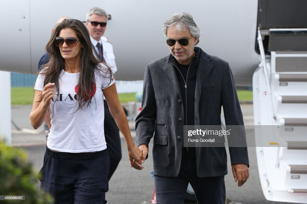Italian singer, <a gi-track='captionPersonalityLinkClicked' href=/galleries/search?phrase=Andrea+Bocelli&family=editorial&specificpeople=211558 ng-click='$event.stopPropagation()'>Andrea Bocelli</a> arrives with his wife Veronica Berti (L) at the Auckland International Airport on September 10, 2014 in Auckland, New Zealand.
