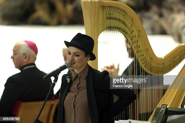 Italian singer Arisa performs during Pope Francis' audience for the health workers at the Paul VI Hall on November 22 2014 in Vatican City Vatican...