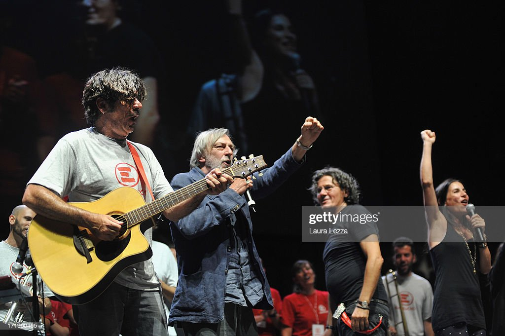 Italian singer Bobo Rondelli, <a gi-track='captionPersonalityLinkClicked' href=/galleries/search?phrase=Gino+Strada&family=editorial&specificpeople=4203022 ng-click='$event.stopPropagation()'>Gino Strada</a> founder of Emergency, editor Nico Colonna and singer <a gi-track='captionPersonalityLinkClicked' href=/galleries/search?phrase=Paola+Turci&family=editorial&specificpeople=2154171 ng-click='$event.stopPropagation()'>Paola Turci</a> perform during the Emergency National Meeting on June 29, 2013 in Livorno, Italy. Italian independent non-profit organisation 'Emergency', which also has a branch in North America, transports doctors and medical equipment to regions suffering from poverty and conflict to provide free treatment to those who need it. Volunteers, supporters and politicians met today to discuss the charity's work with the theme of 'Rights and Privileges'.