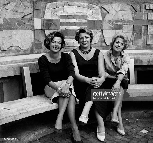 Italian singer Carla Boni and the Duo Fasano formed by Italian singers Delfina and Dina sitting on a bench decorated by Bruno Munari Francesco...