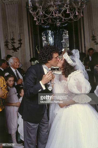 Italian singer Christian and Italian singer and TV assistant Dora Moroni kissing on the day of their wedding Cremnago 26th May 1986
