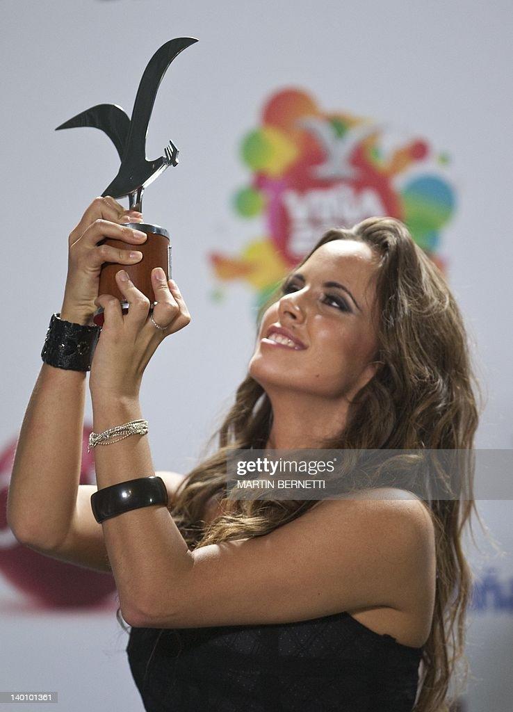 Italian singer Denise Faro show a silver seagull award during the 53nd Vina del Mar International Song Festival on February 27, 2012 in Vina del Mar, Chile. Faro won a International Song Festival.