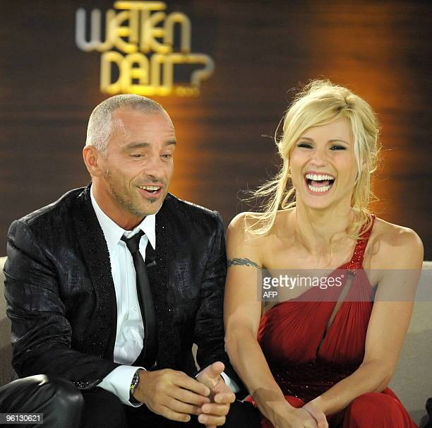 Italian singer Eros Ramazotti and his exwife Swiss TV host Michelle Hunziker smile on stage during the 186th edition of the TV show 'Wetten dass' on...