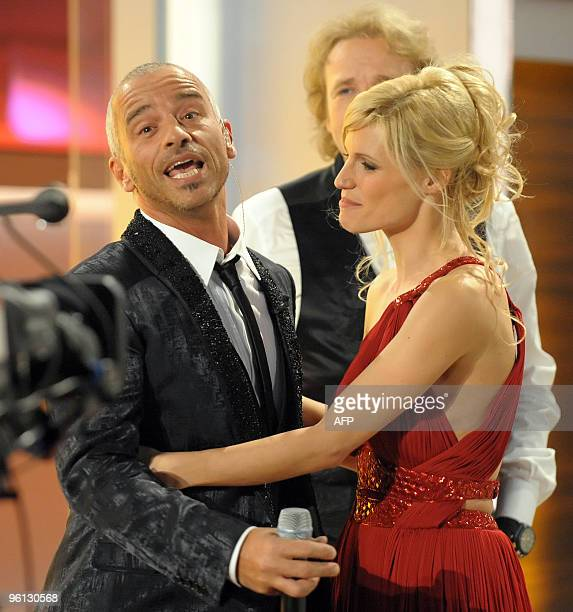 Italian singer Eros Ramazotti greets his exwife Swiss TV host Michelle Hunziker during the 186th edition of the TV show 'Wetten dass' on January 23...