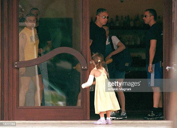 Italian singer Eros Ramazzotti right visits with his daughter Aurora July 4 2001 in Marittima Italy Ramazzotti traveled away from his current tour to...