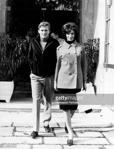 Italian singer Fabrizio Ferretti walking with Italian singer Iva Zanicchi 1965