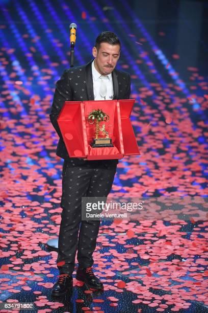 Italian singer Francesco Gabbani winner of the 67th Italian Music Festival in Sanremo pose with the award at Teatro Ariston on February 11 2017 in...