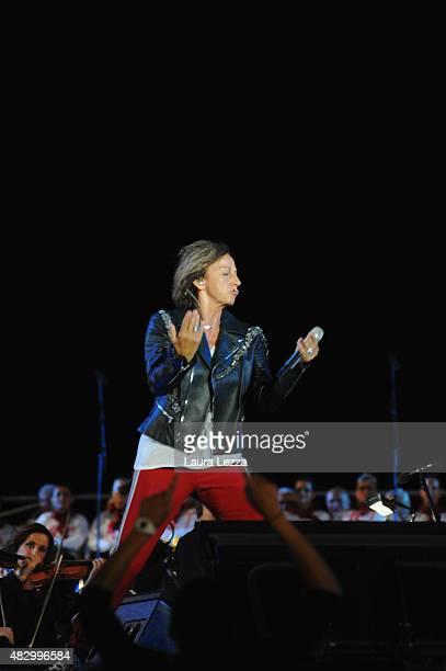 Italian singer Gianna Nannini performs on stage at Teatro del Silenzio during the 10th edition of Andrea Bocelli's Teatro del Silenzio summer concert...