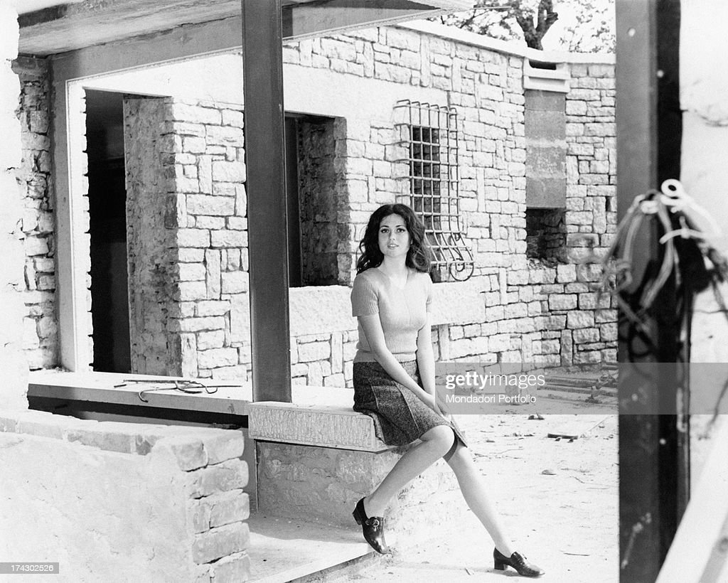 Italian singer Gigliola Cinquetti sitting at the entrance her villa looking at the camera and posing seductively Cerro Veronese Italy 1968