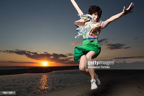 Italian singer Giorgia jumping at Capocotta beach for a photo shooting Lido di Ostia 18th May 2012