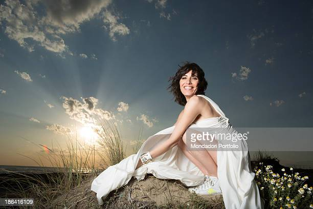Italian singer Giorgia posing smiling at Capocotta beach for a photo shooting Lido di Ostia 18th May 2012