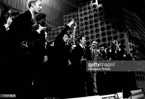 Italian singer Iva Zanicchi and Italian singer and actor Claudio Villa celebrating on stage their victory at the 17st Sanremo Music Festival Sanremo...