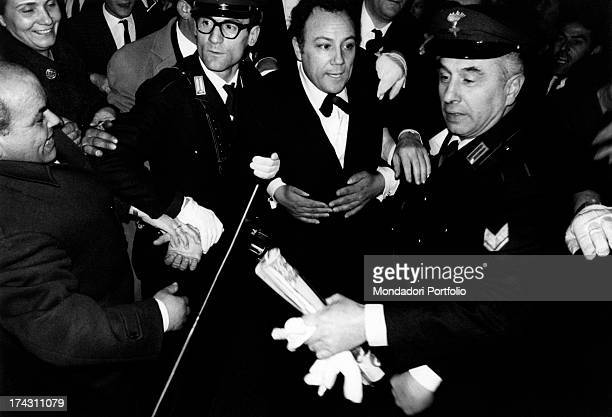 Italian singer Iva Zanicchi and Italian singer and actor Claudio Villa being interviewed by the journalists after their victory at the 17st Sanremo...
