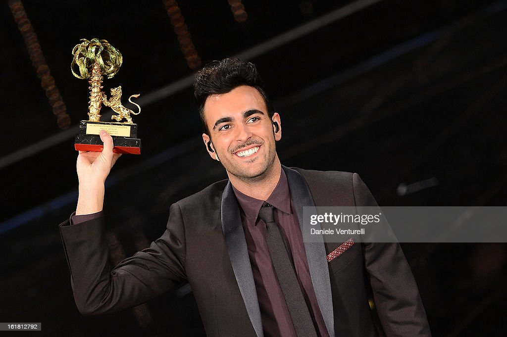 Italian singer <a gi-track='captionPersonalityLinkClicked' href=/galleries/search?phrase=Marco+Mengoni&family=editorial&specificpeople=6745965 ng-click='$event.stopPropagation()'>Marco Mengoni</a>, winner of the 63th Italian Music Festival in Sanremo, poses with his trophy at the Ariston theatre during the closing night on February 16, 2013 in Sanremo, Italy.