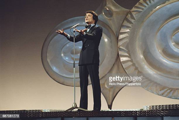 Italian singer Massimo Ranieri performs the song 'L'amore e un attimo' on stage for Italy in the 1971 Eurovision Song Contest at the Gaiety Theatre...