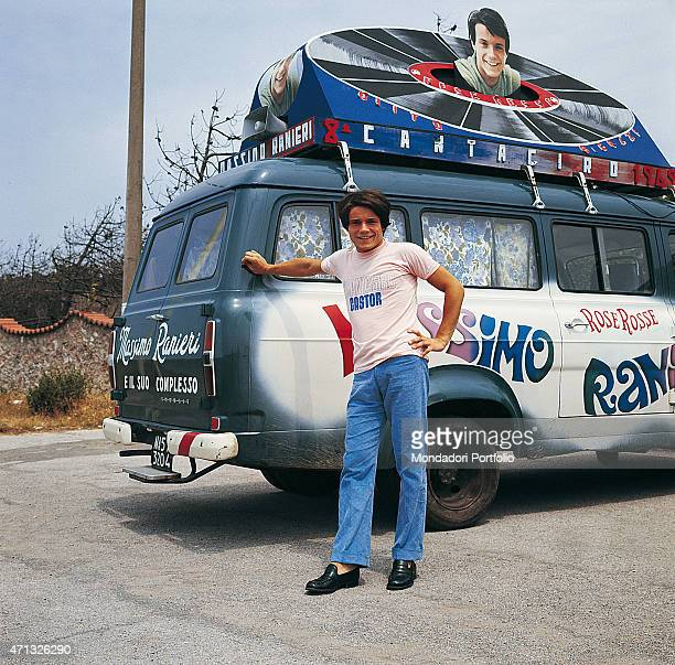 Italian singer Massimo Ranieri posing beside a van with a poster advertising his participation in the 8th Cantagiro with the song 'Rose Rosse' Photo...