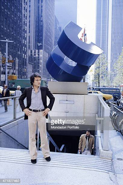 Italian singer Massimo Ranieri posing for a photo shooting in front of the entrance of the underground in the American city New York 1973