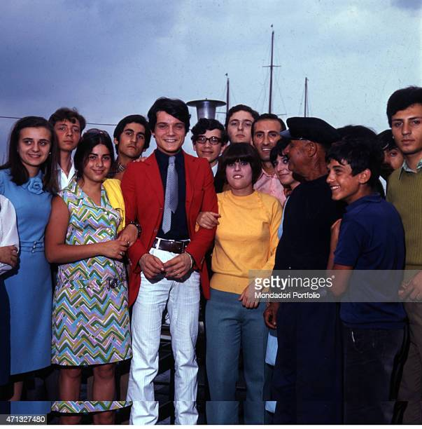 Italian singer Massimo Ranieri surrounded by many people of his same age taking part in the singing context 'Fuori la voce' held by the weekly...