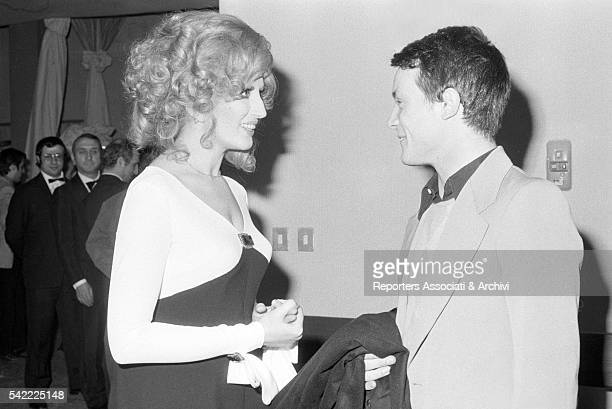 Italian singer Mina and Italian singer and actor Massimo Ranieri talking in the backstage of TV show Teatro 10 1972