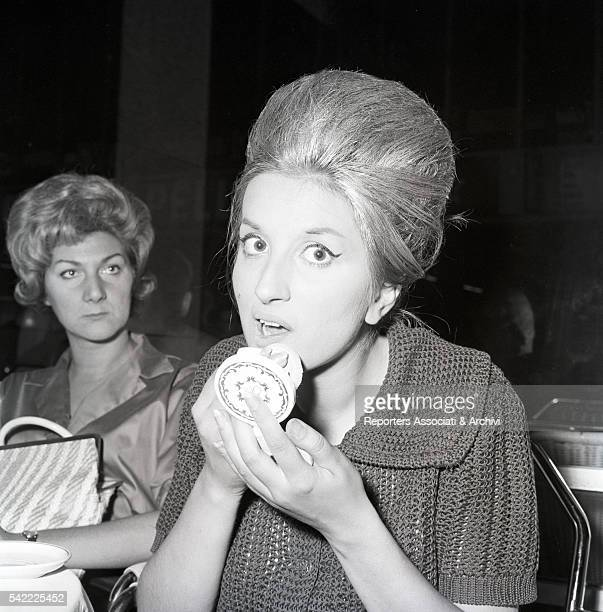Italian singer Mina in a cafŽ at Termini station Rome 1961