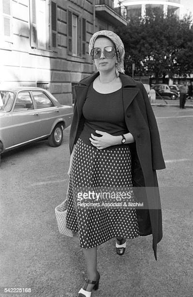 Italian singer Mina pregnant with her daughter Benedetta coming out of a TV studio 1971