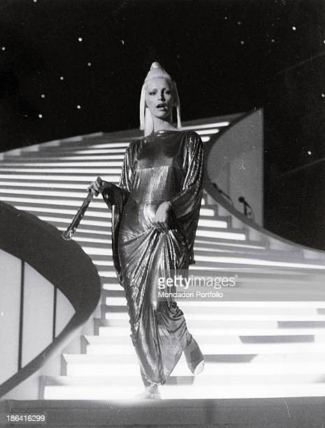 Italian singer Patty Pravo coming down the staircase at the 34th Sanremo Music Festival wearing a Japanstyle dress by Gianni Versace She takes part...