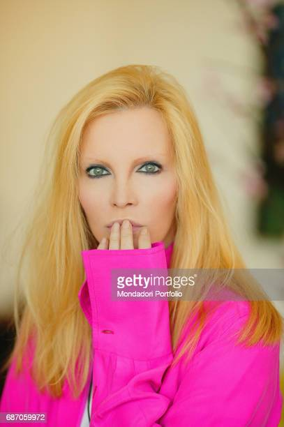 Italian singer Patty Pravo hand on mouth in her house in Rome Rome 1990s