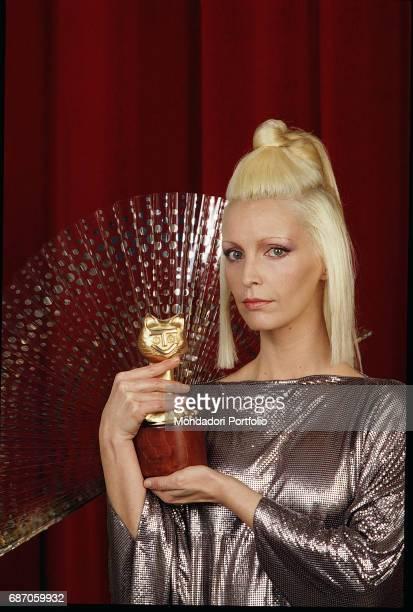 Italian singer Patty Pravo holding the Telegatto award Italy 1980s