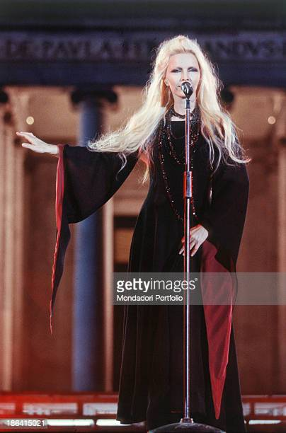 Italian singer Patty Pravo performing at 37th Festivalbar wearing a butterfly sleeve dress Naples 30th May 2000